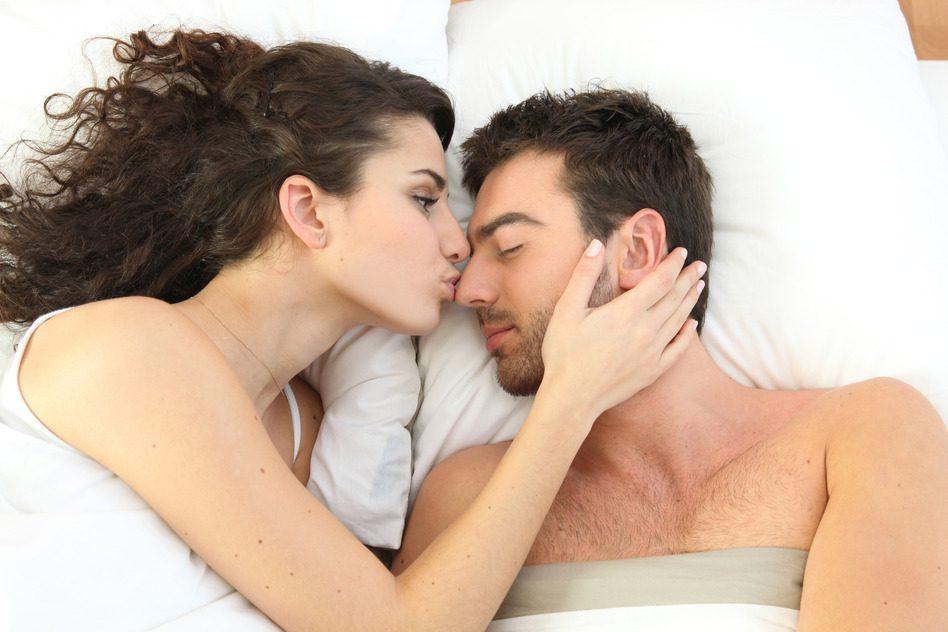 Teens kissing in bed